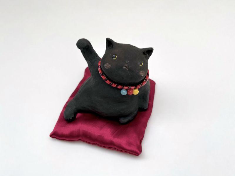 白昱軒-小黑側躺招財貓